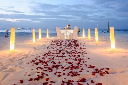 Cena romántica en la playa de Cancún
